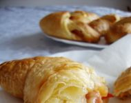 Croissants with sausages, cheese, paprika and kethup